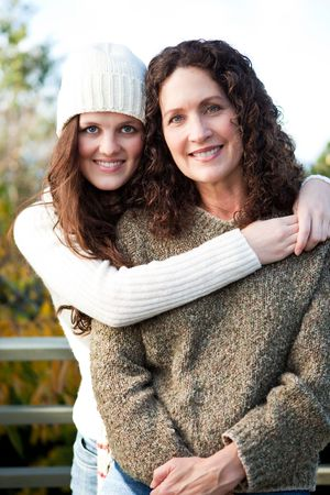 teen aged: A portrait of a happy mother and daughter outdoor