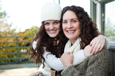 A portrait of a happy mother and daughter outdoor photo