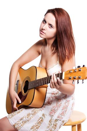 An isolated shot of a beautiful caucasian woman with a guitar photo