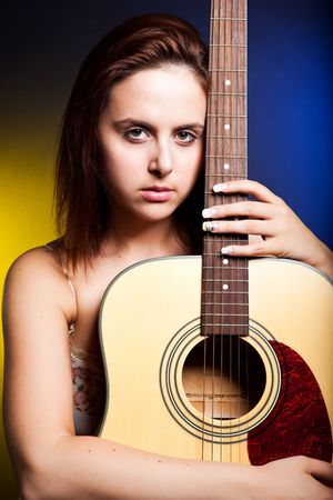 A shot of a beautiful caucasian woman with a guitar photo
