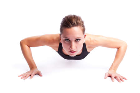pushup: An isolated shot of a beautiful caucasian woman doing exercise