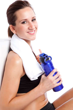 An isolated shot of a beautiful caucasian woman sitting after exercise Stock Photo - 6002671