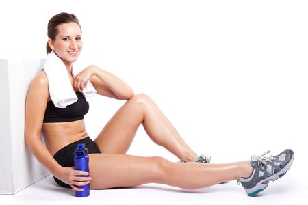 An isolated shot of a beautiful caucasian woman sitting after exercise Stock Photo - 6002707