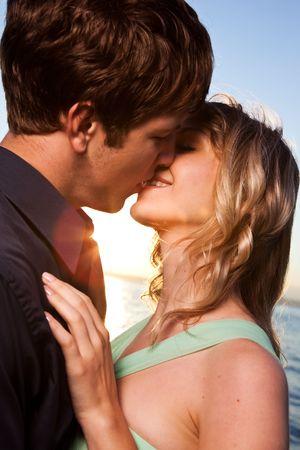 love kiss: A romantic caucasian couple in love on the beach Stock Photo