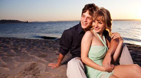 A romantic caucasian couple in love on the beach Stock fotó