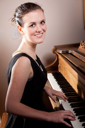 A portrait of a beautiful teenager playing piano Stock Photo - 6245831