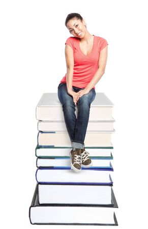 An isolated shot of a beautiful black college student sitting on a stack of books Stock Photo - 6245846