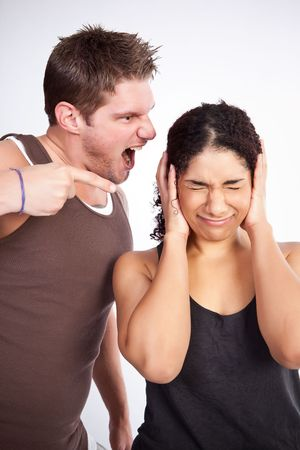 yell: A personal trainer screaming at a woman Stock Photo