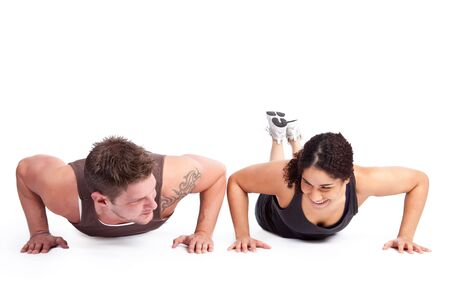 pushup: A woman doing pushups with her personal trainer