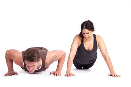 envious: A woman doing pushups with her personal trainer
