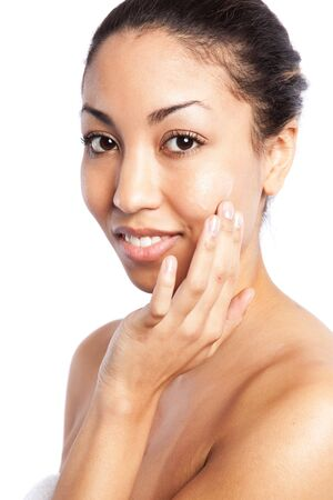 treatment: An isolated shot of a beautiful black woman applying  lotion