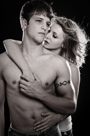 passionate embrace: A shot of a man and a woman in love in black and white
