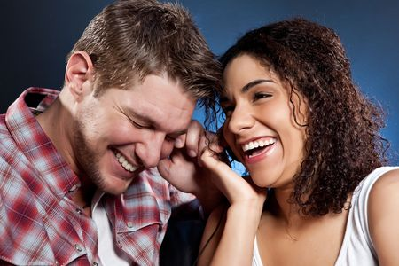 A portrait of a beautiful romantic interracial couple in love photo