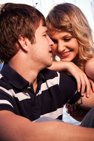 A romantic caucasian couple in love at the marina outdoor Stock Photo - 6309424