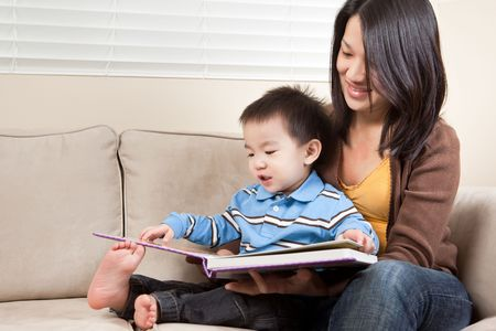 A portrait of a mother and a son reading a book photo