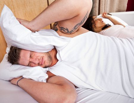 A man unable to sleep because of the snoring sound photo