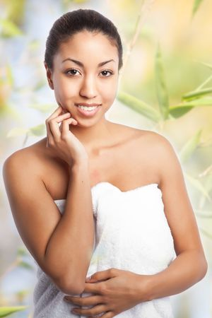 body spa: A shot of a beautiful black woman in the spa