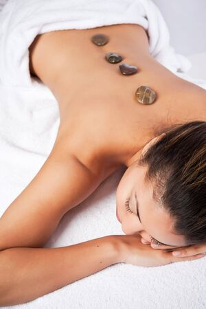 african american spa: A shot of a black woman lying down at a spa Stock Photo