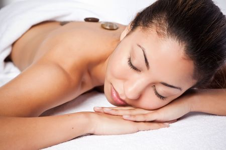 A shot of a black woman lying down at a spa Stock Photo - 6432845