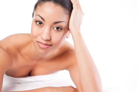 salon and spa: A shot of a black woman lying down at a spa Stock Photo