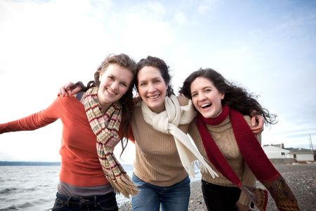 A mother having fun with her daughters on the beach Stock Photo - 6432887