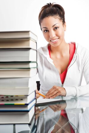 A shot of a beautiful black college student studying Stock Photo - 6470979