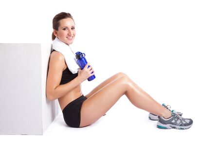 An isolated shot of a beautiful caucasian woman sitting after exercise Stock Photo - 6471000