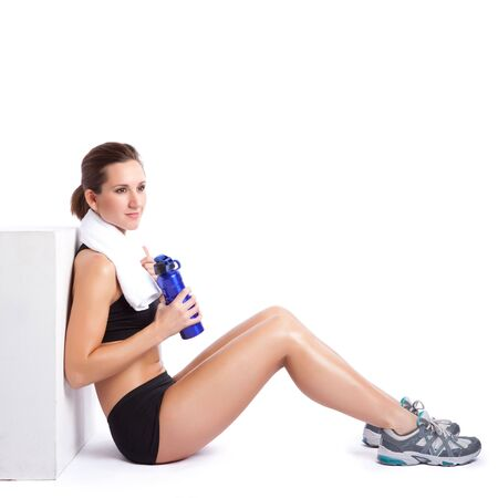 An isolated shot of a beautiful caucasian woman sitting after exercise Stock Photo - 6470995