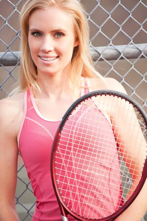 A beautiful caucasian tennis player on the tennis court Stock Photo - 6592607