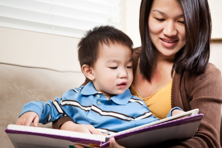 A portrait of a mother and a son reading a book Stock Photo - 6617105