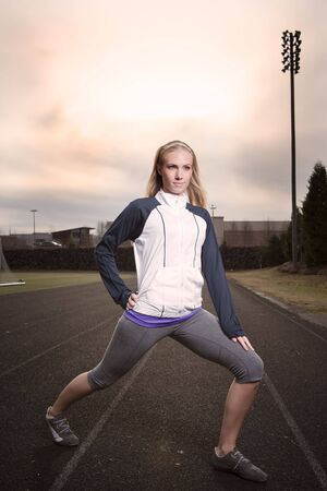 A beautiful caucasian woman exercises in a sport field Stock Photo - 6645065