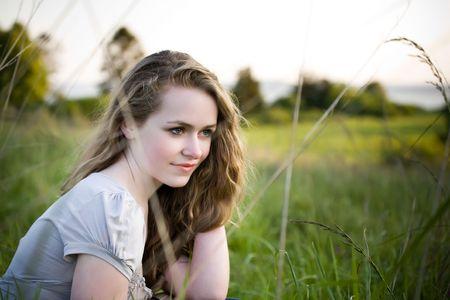 blonde teenage girl: A beautiful caucasian teenage girl outdoor in summer Stock Photo