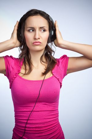 A beautiful caucasian woman listening to music on headphones photo