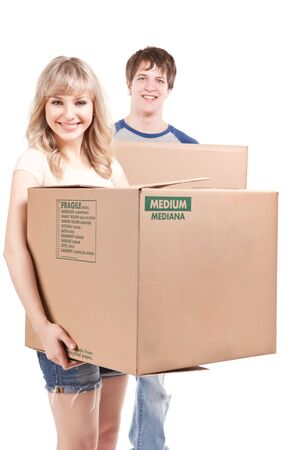 An isolated shot of a moving couple carrying boxes