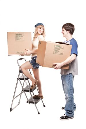An isolated shot of a moving couple carrying boxes photo