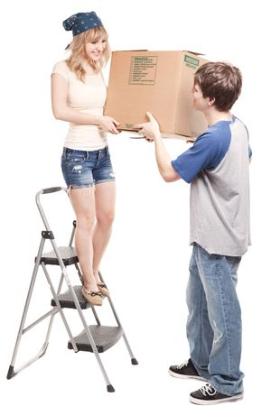 carrying: An isolated shot of a moving couple carrying boxes Stock Photo