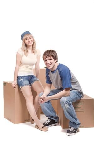 An isolated shot of a moving couple carrying boxes Stock Photo - 6827490