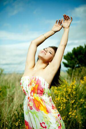 joyous: A portrait of a happy beautiful mixed race girl outdoor