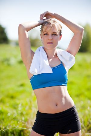 A shot of a beautiful caucasian woman exercises outdoor Stock Photo - 6882787