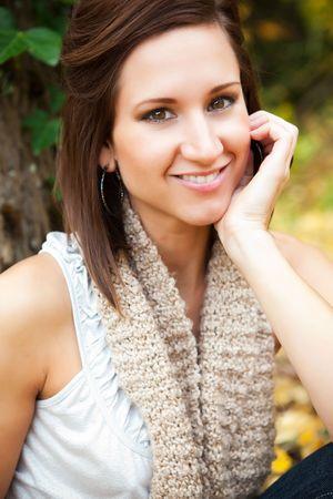 A portrait of a beautiful caucasian woman outdoor in autumn season photo