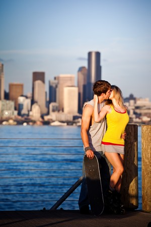lovers kissing: A shot of a young caucasian couple kissing outdoor