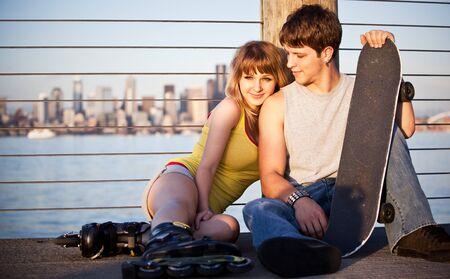 boy skater: A shot of a young caucasian couple outdoor