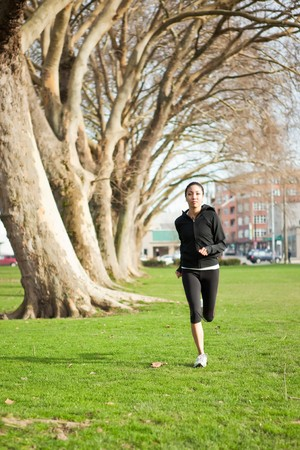 A shot of a beautiful black woman exercises outdoor photo