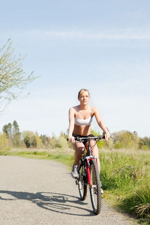 A sporty woman riding a bicycle outdoor Reklamní fotografie - 6882889