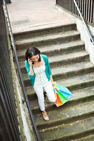 A shopping black woman talking on her phone Stock Photo - 7013166