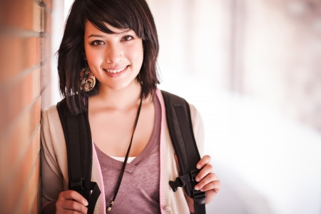 college campus: A portrait of a mixed race college student at campus Stock Photo