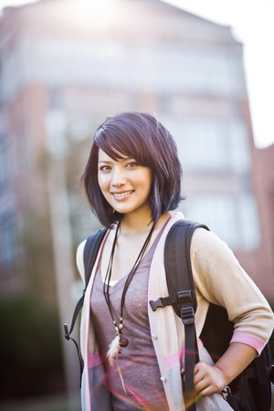 A portrait of a mixed race college student at campus photo