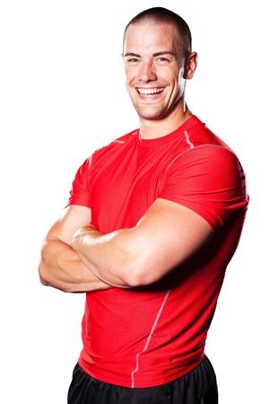 Een geïsoleerde portret van een glimlachende gespierde caucasian atleet  Stockfoto