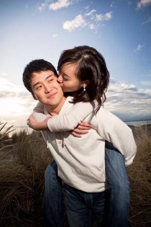 A portrait of an asian couple having fun outdoor