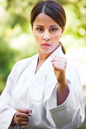 stance: A shot of an asian woman practicing karate